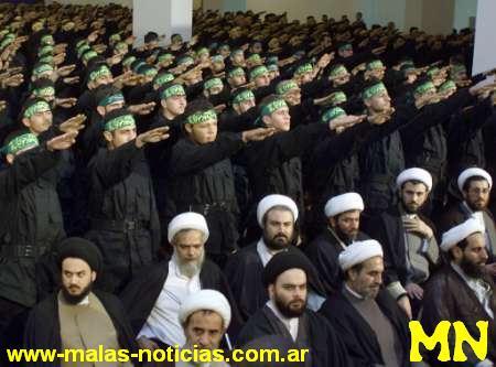 Des centaines de terroristes kamikazes iraniens au salut hitlérien, entourés d'autorités religieuses qui ne disent mot (donc consentent)